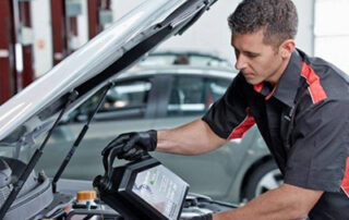 Mechanic pouring oil for mechanical repairs in Earlwood